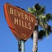 Beverly Hills sign with tall palm tree